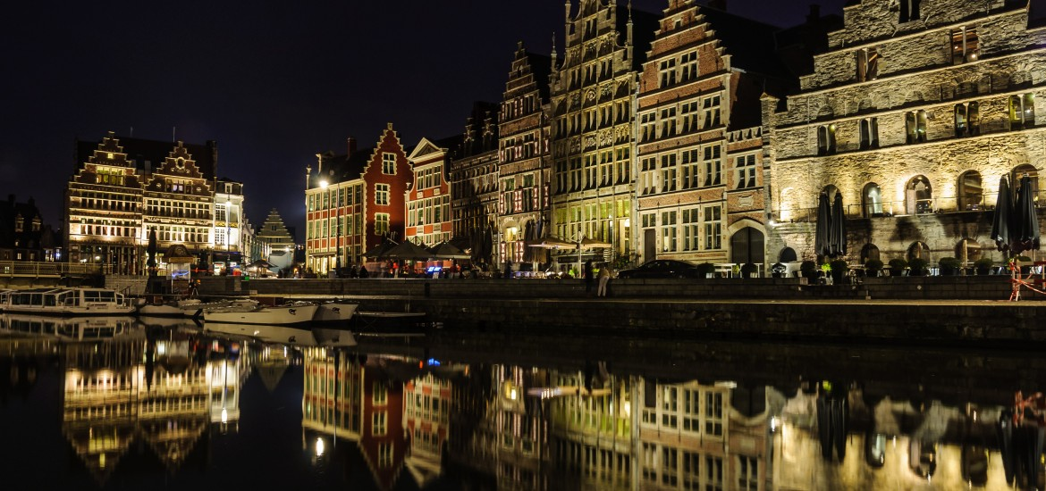 Reflection of medieval buildings at night in Ghent Flanders Belgium